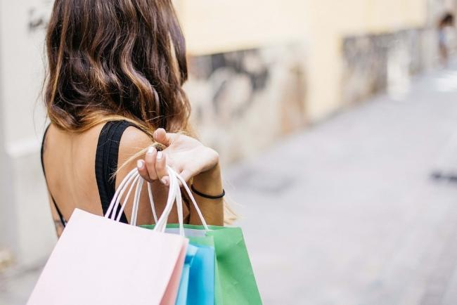 A stock picture of a woman with shopping bags