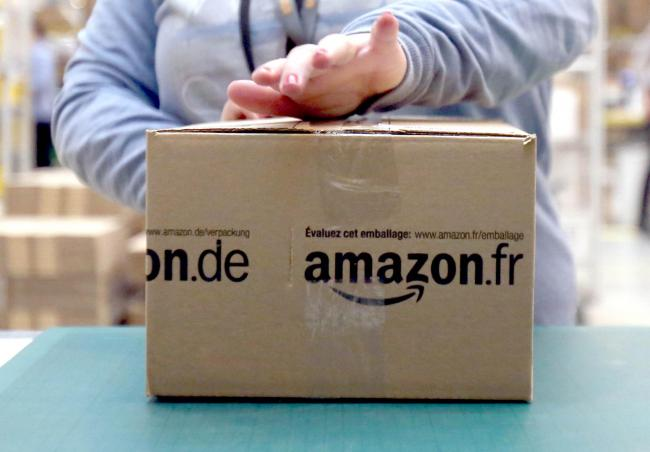 File photo dated 28/11/13 of an Amazon package. Attempts by Amazon to eat into the UK food delivery sector suffered a blow on Friday when the competition watchdog revealed it was launching an inquiry into a deal with Deliveroo. PRESS ASSOCIATION Photo. I