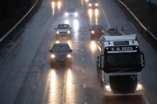 Vehicles drive through wet conditions on the M6 near Birmingham