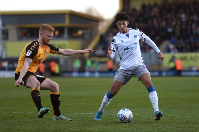 Recall  - Colchester United winger Courtney Senior looks to get past Cambridge United's Liam O'Neil during the U's 2-1 loss at the Abbey Stadium Picture: RICHARD BLAXALL