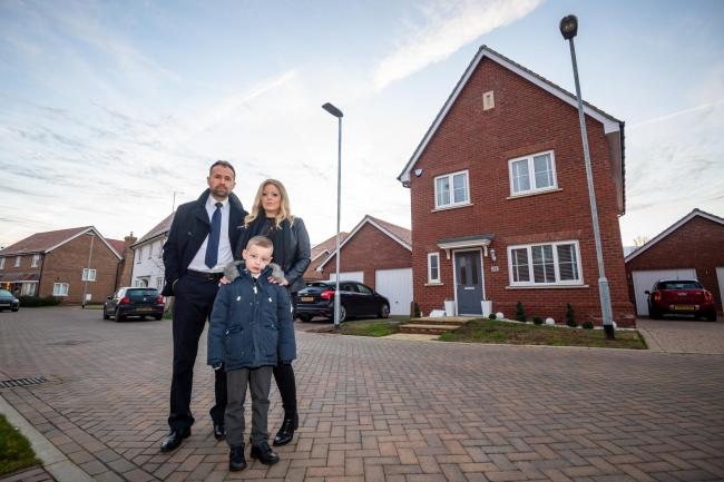 Steve Price and his wife and son outside his home in Maldon, Essex.