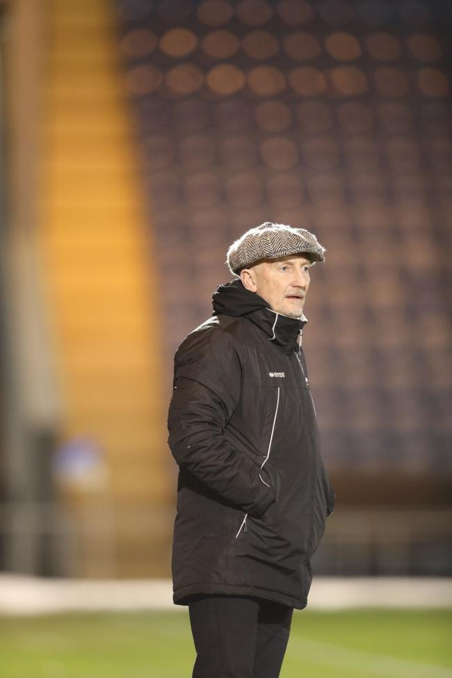 In charge - Grimsby Town boss Ian Holloway watches his side in action at Colchester United Picture: Steve Brading