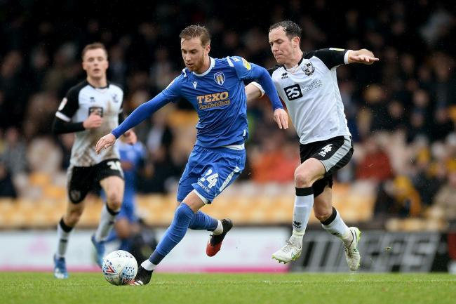 Ben Stevenson of Colchester United looks to get past Luke Joyce of Port Vale - Port Vale vs. Colchester United - Sky Bet League Two - Vale Park, Burslem - 15/02/2020 - Photo by: Richard Blaxall