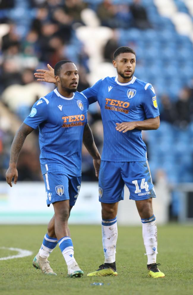 Team work - Brandon Comley (right) and Callum Harriott celebrate after playing their part in a Colchester United goal against Plymouth Argyle Picture: STEVE BRADING