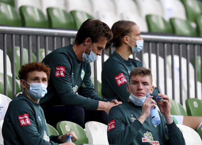 Strange days - Werder Bremen substitutes sit on the bench during their side's German Bundesliga match against Bayer Leverkusen 04 Picture: AP Photo/Stuart Franklin, Pool