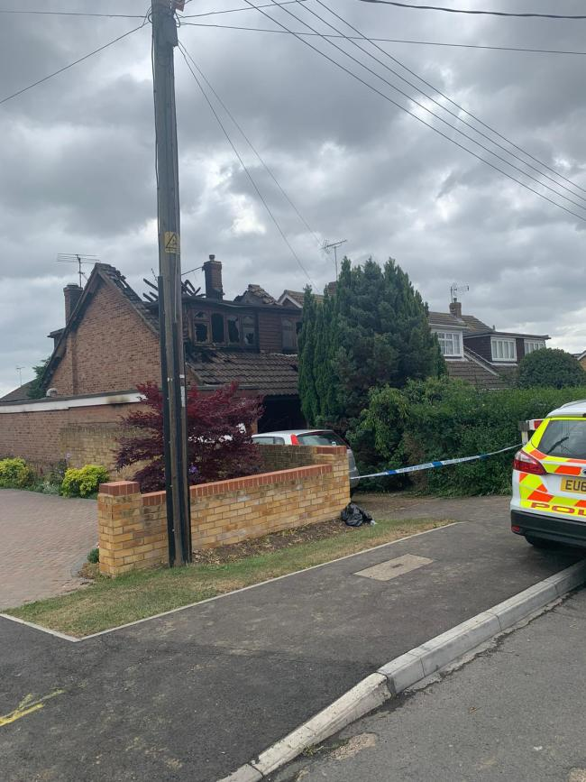 Aftermath - the fire tore through and destroyed the detached home in Friern Gardens