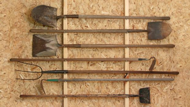 Chelmsford Weekly News: Get heavy tools, rakes, shovels, etc., off the floor using utility hooks or, even, nails. Credit: Getty Images / Twoellis
