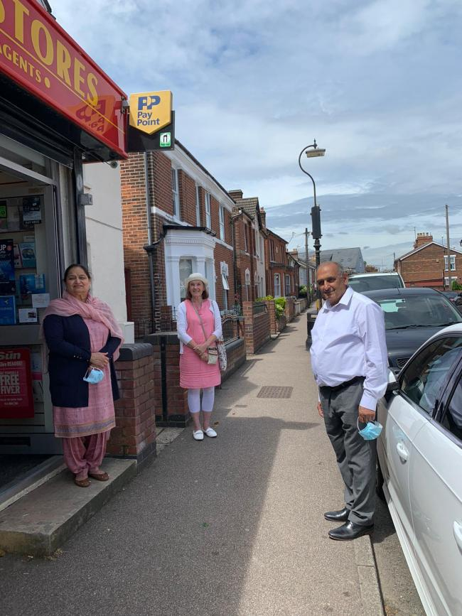 Community - Baljinder and Harminder Johal leave their shop as New Town councillor Theresa Higgins bids them a happy retirement