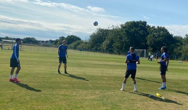 Heads up - Colchester United's players take part in training after returning for pre-season ahead of the new League Two campaign Picture: WWW.CU-FC.COM