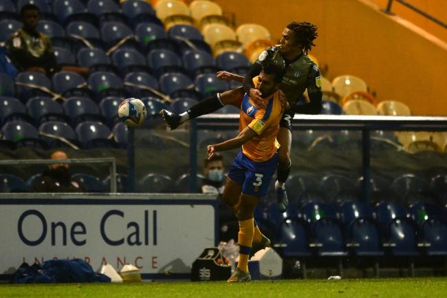Tussle - Colchester United's Miles Welch-Hayes does battle with Malvind Benning of Mansfield Town in the 1-1 draw at One Call Stadium Picture: RICHARD BLAXALL