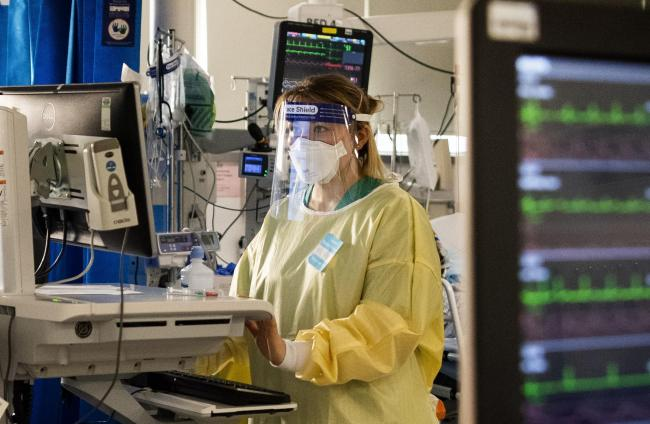 A nurse works on a computer in the ICU (Intensive Care Unit) in St George's Hospital in Tooting, south-west London. Picture: PA