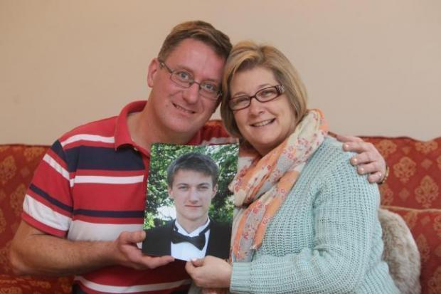 Chelmsford Weekly News: Richard and Nikki Bowdidge with a photo of son Tom
