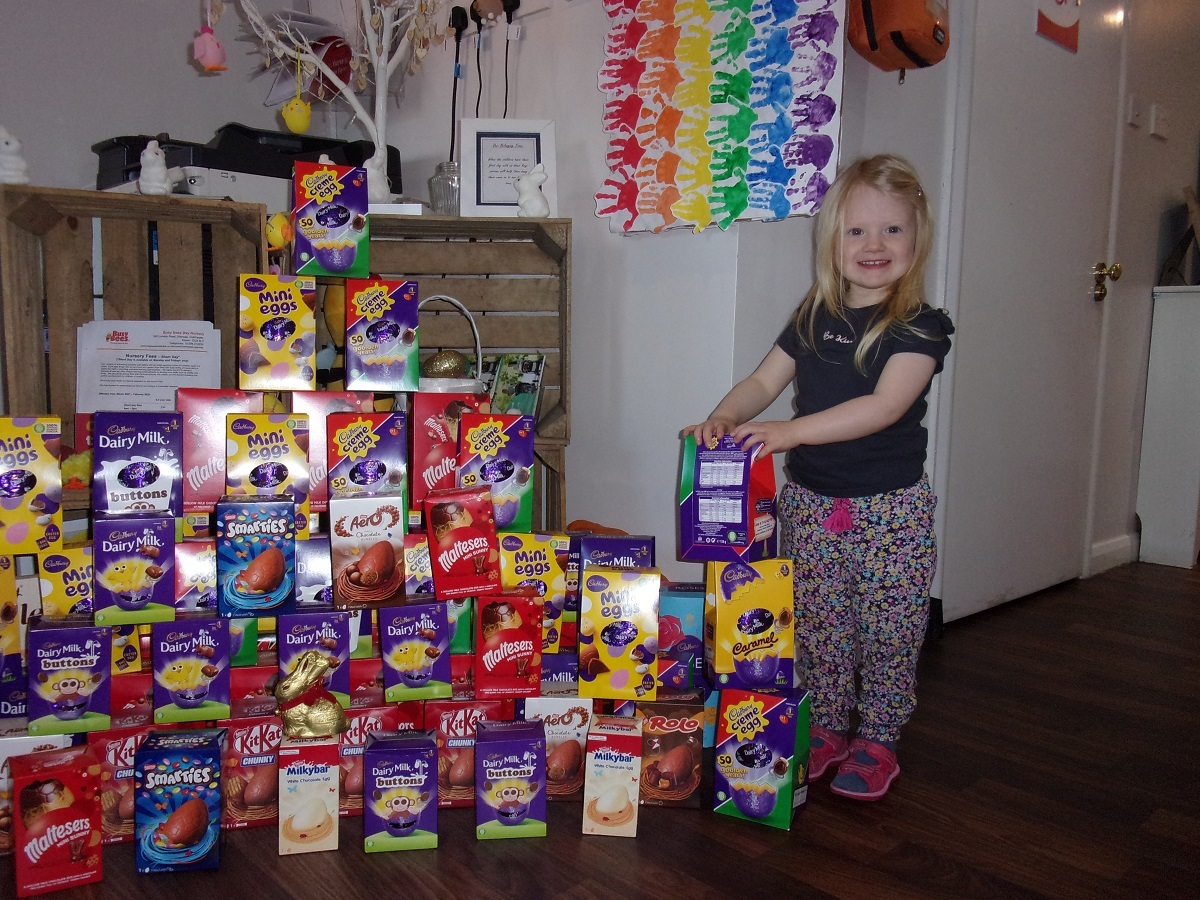 So sweet - Rosie Heppleston adds her egg to the donation mountain at Busy Bees Day Nursery