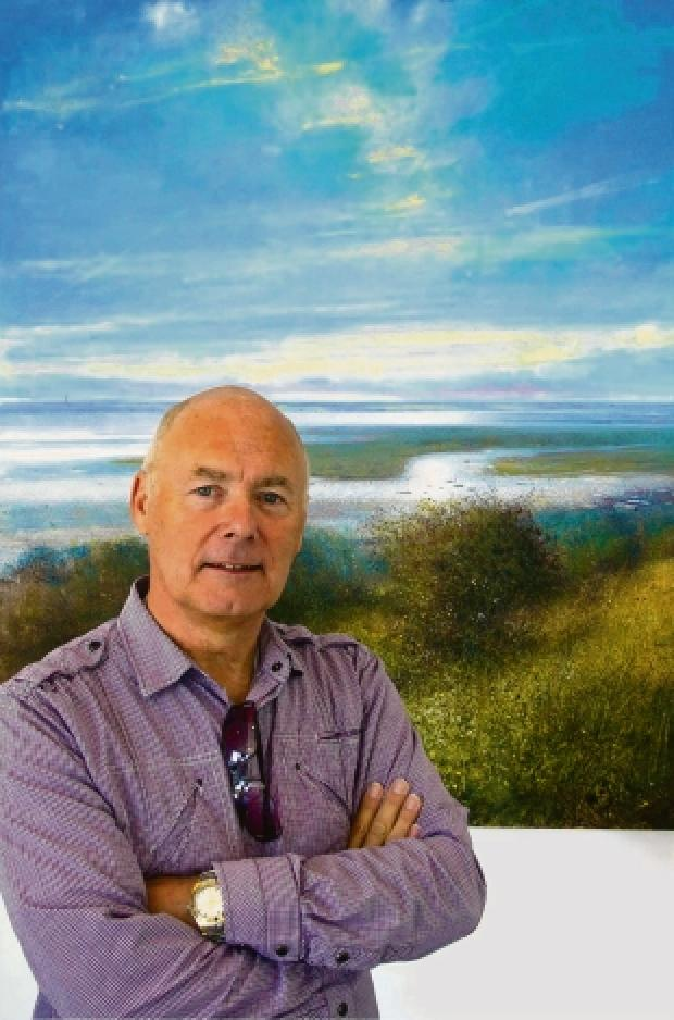 Jonathan Trim in front of one of his estuary-inspired paintings