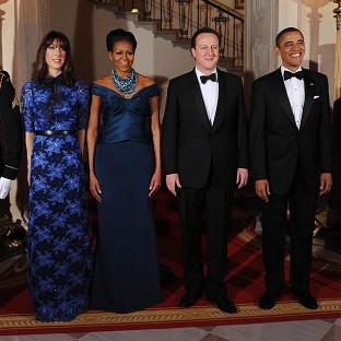 Prime Minister David Cameron and wife Samantha are greeted by US President Barack Obama and wife Michelle ahead of a state dinner
