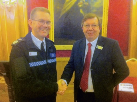 Essex Police Chief Constable Jim Barker-McCardle is welcomed to the AGM by Chelmsford CAB chief executive Russ Mynott