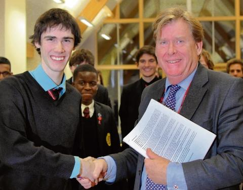 Chelmsford MP Simon Burns with Year 13 KEGS student Tim Lornie, who