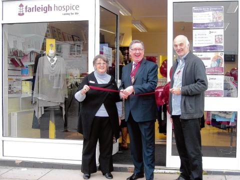 Shop manager Chris Hayward, deputy mayor Paul Hutchinson and Farleigh Hospices' Jonathan Stokes