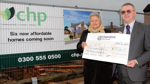 Chelmer Housing Partnership chairman Ursula Heelis received the cheque from councillor Duncan Lumley