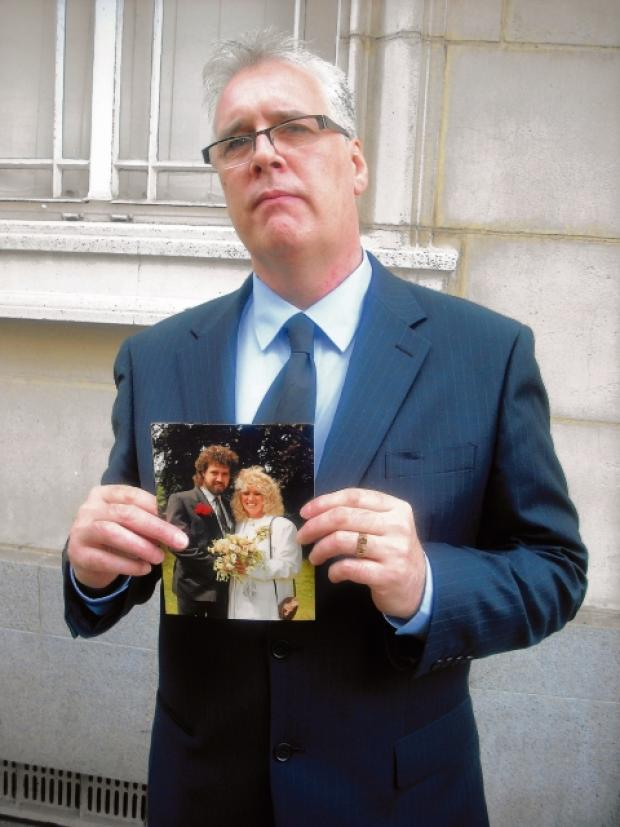 Colin Green at the inquest with a picture of Christine