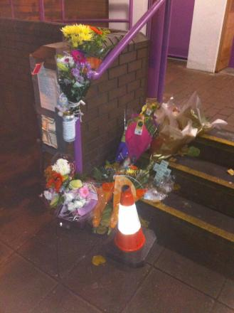 Floral tributes left outside the toilet block where Mr Hiskey died