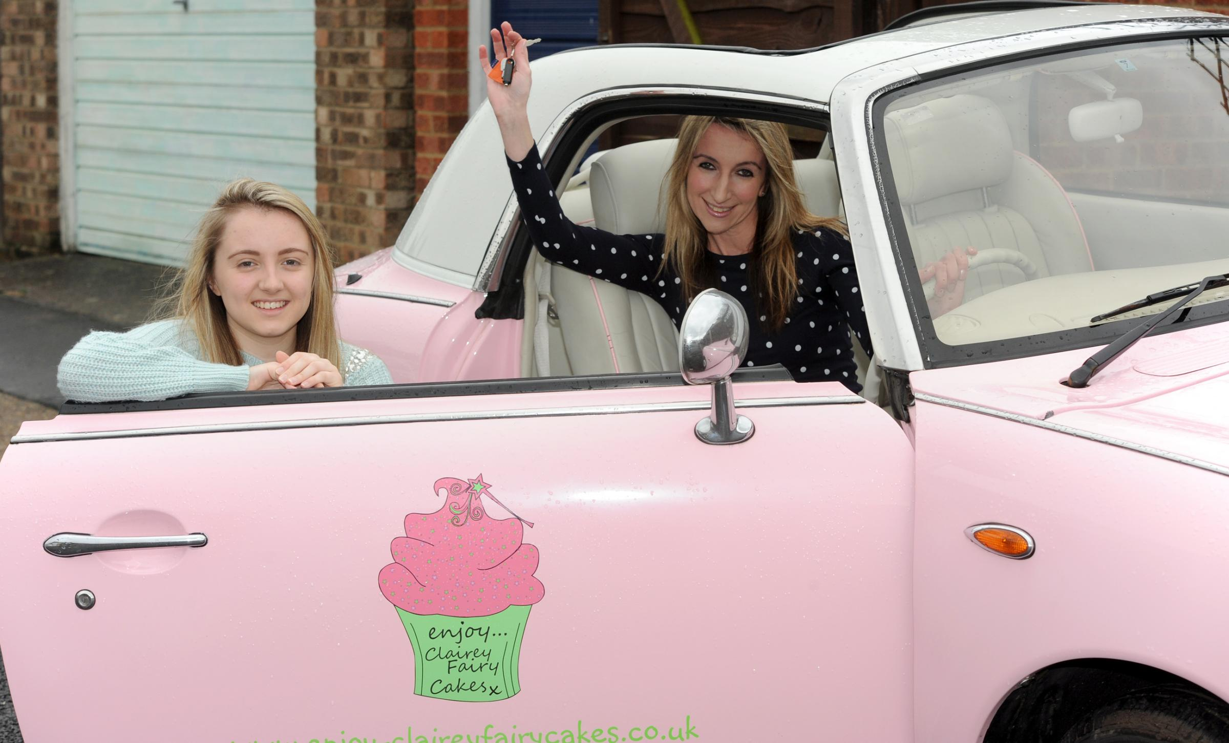 Tracey Atkins with her daughter Amy and the car she won. Pic: Luan Marshall