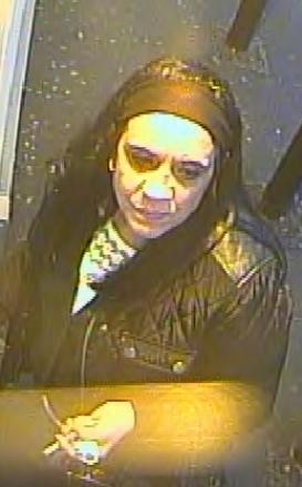 CCTV image released by police of a woman they wish to speak to regarding the incident