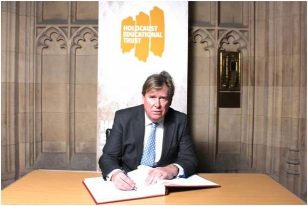 Chelmsford Weekly News: Simon Burns, MP for Chelmsford, signing the book