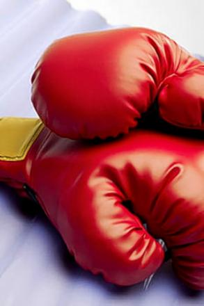 BOXING: Defeat a surprise