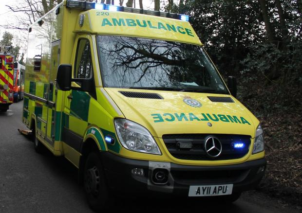 Three in hospital after car overturns