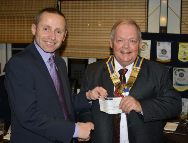 Peter Hall from Little Havens Hospice receiving the donation from Rotary Club President Keith Clark