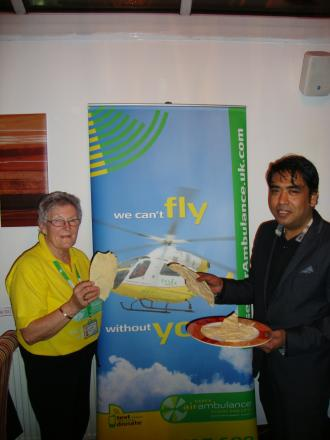 Teresa James from Essex Air Ambulance and Indian Night owner Azad Ali