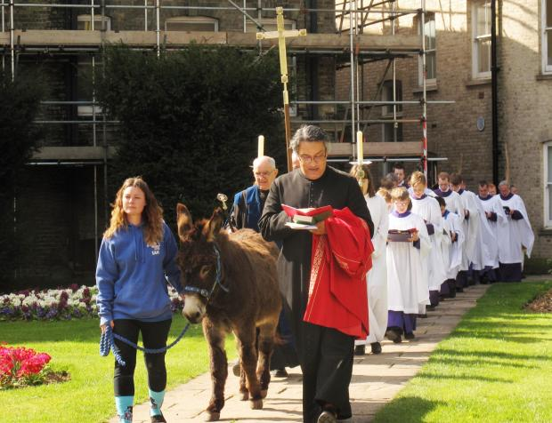 Donkey leds procession around Chelmsford Cathedral