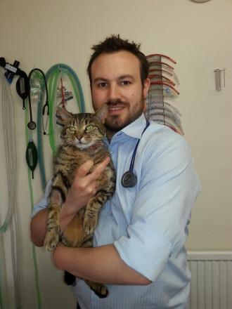 Simba with vet Ian Wooding after the operation