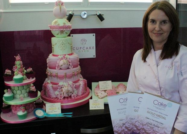 Sarah Thomas with her medal winning cakes