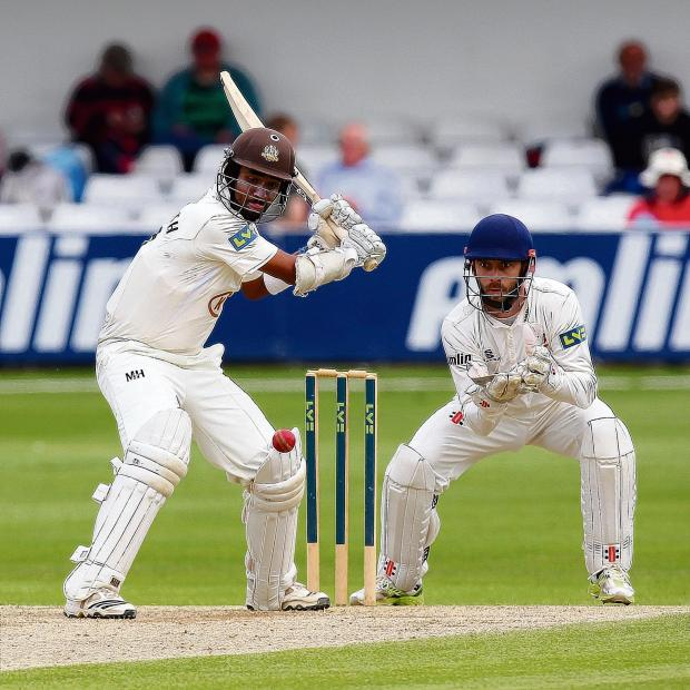 Chelmsford Weekly News: James Foster looks on as Arun Harinath hits out for Surrey