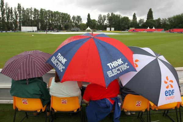 Chelmsford Weekly News: Spectators group underneath umbrellas at Colchester. PIC: GAVIN ELLIS/TGS PHOTOS