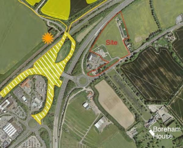 The site of the proposal (in red), off of the A12.