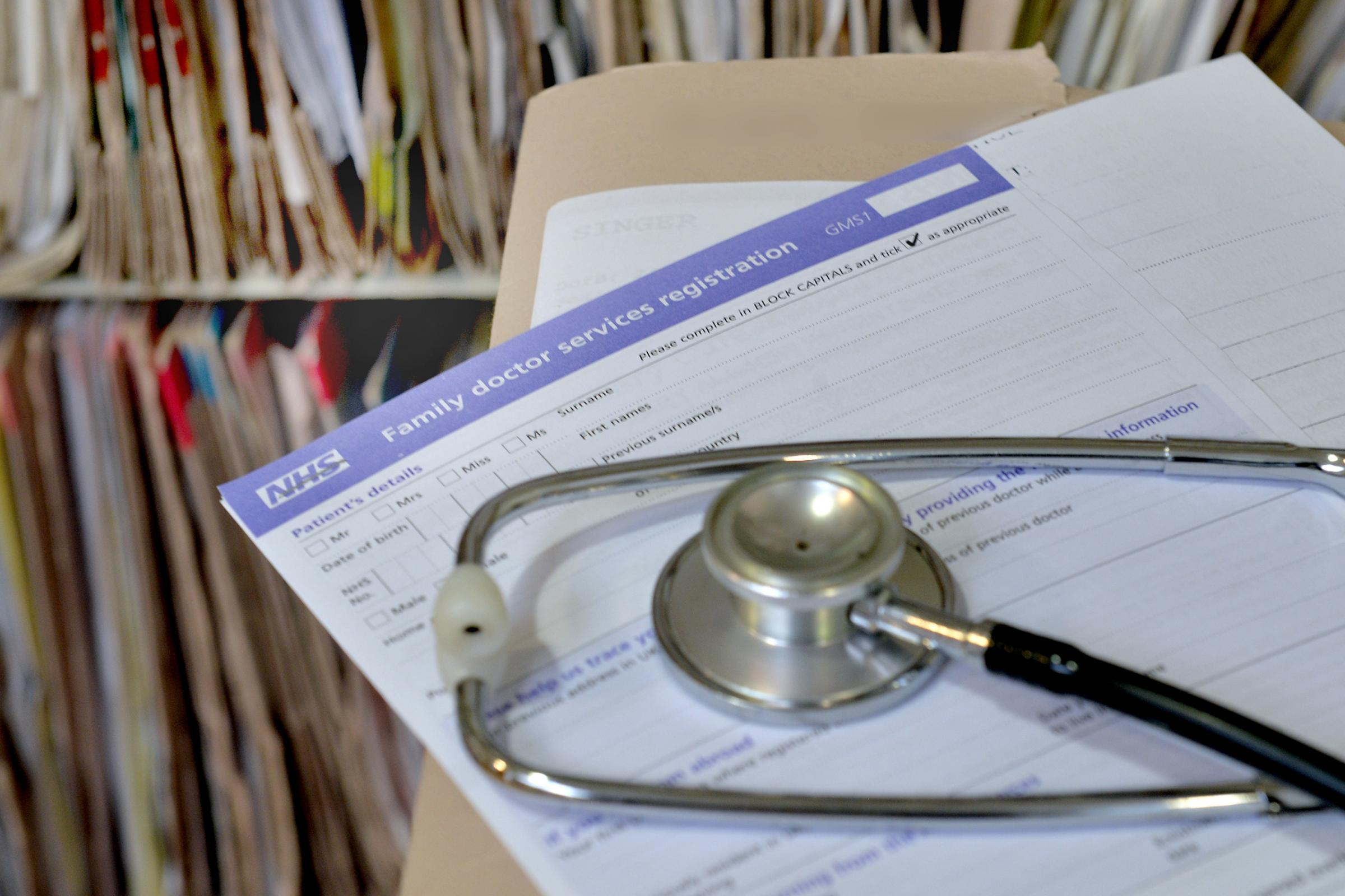 A registration form and a stethoscope
