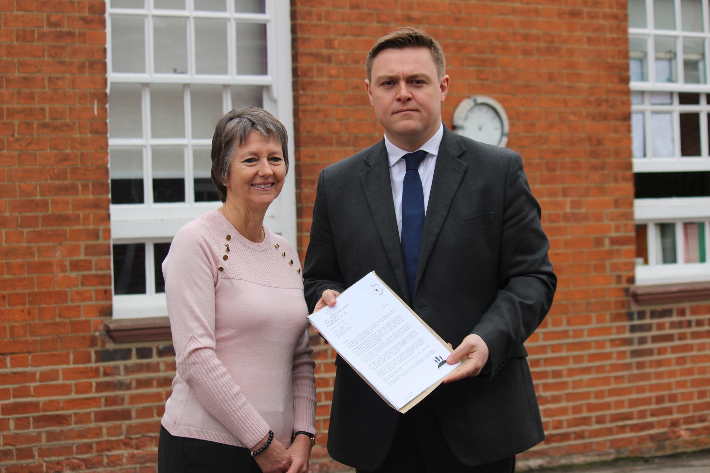 Pressure - Jan Blackwell, chair of governors at North Primary School, presenting letter signed by nearly 300 parents, to Will Quince, MP for Colchester, asking him to demand more money for schools from the Government.