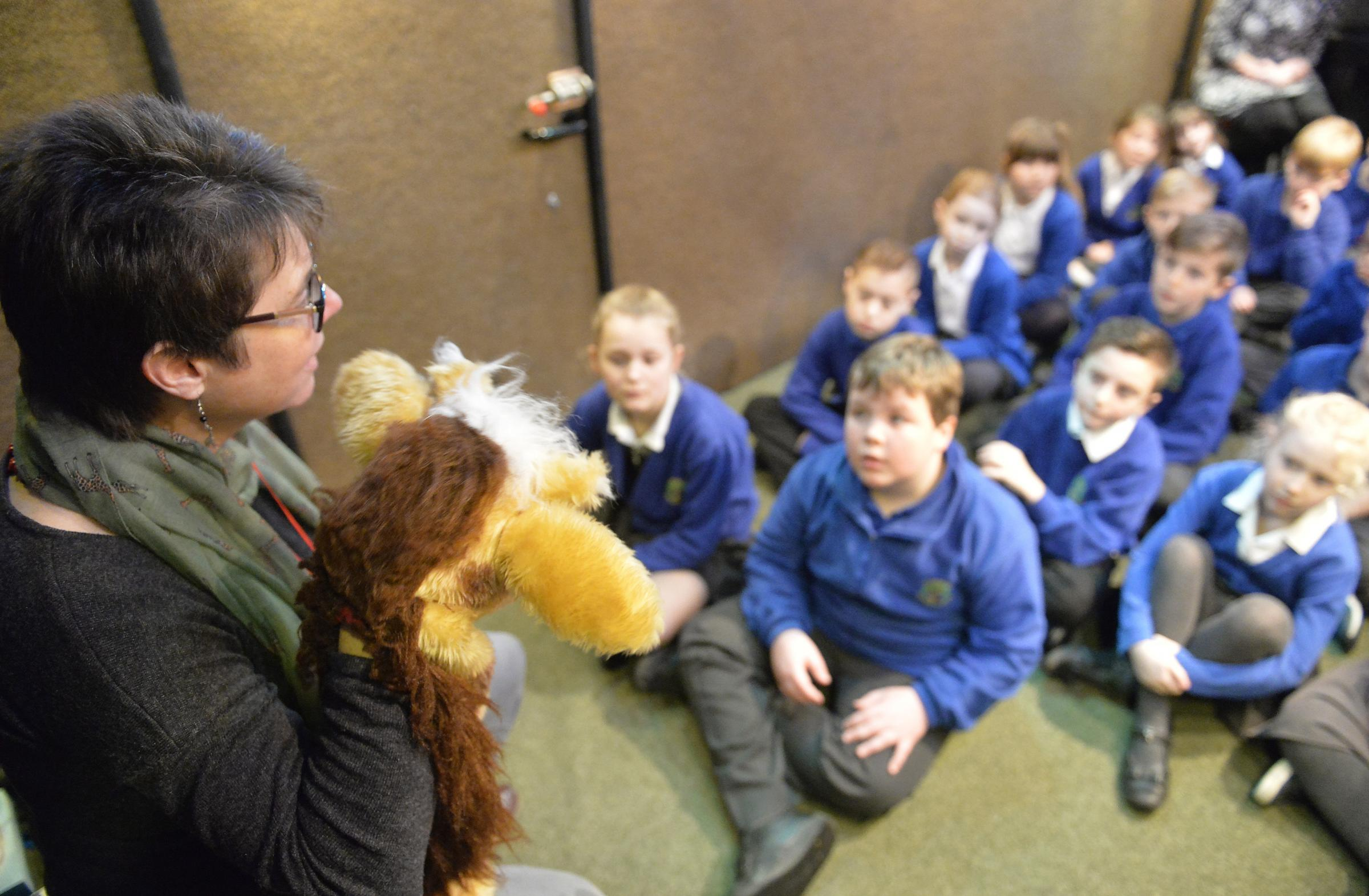 Coram Life Education bus visiting Highfields Primary School in Lawford..Senior Educator Nancy Hughes (with a little help from Harold the Giraffe) with year four pupils..