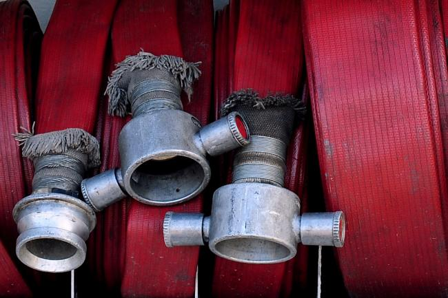 Fire hoses, as firefighters put out a blaze that started in one of the stages late on Wednesday night
