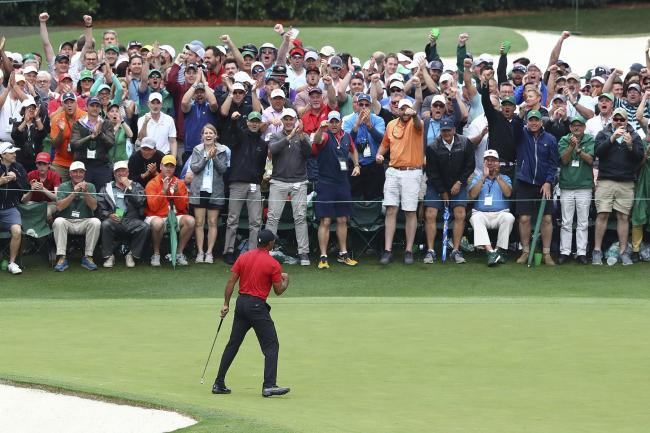 Tiger Woods celebrates his Masters victory in front of the spectators on the 18th green at Augusta