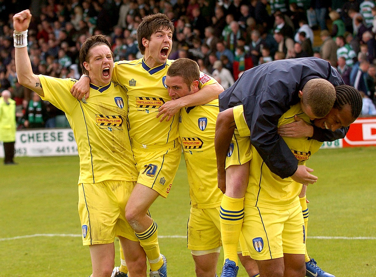 Jubilation - John White (centre) celebrates Colchester United's draw at Yeovil Town which clinched them promotion to the Championship in 2006